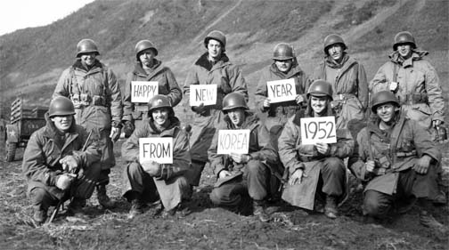 Missouri infantrymen pose for a New Year greeting, 19th Infantry Regiment, Kumsong front, Korea, 14 December 1951